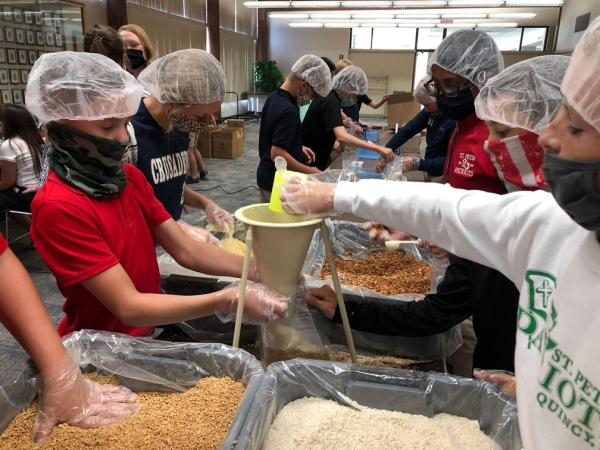 Faith in action: Hundreds pack 18,000+ servings of food to help earthquake victims in Haiti
