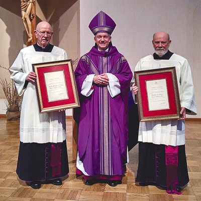 Ecclesiastical honors to two