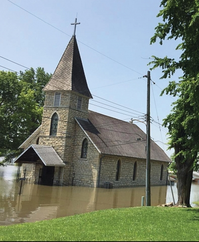 Flood waters invading nearly 150-year-old church