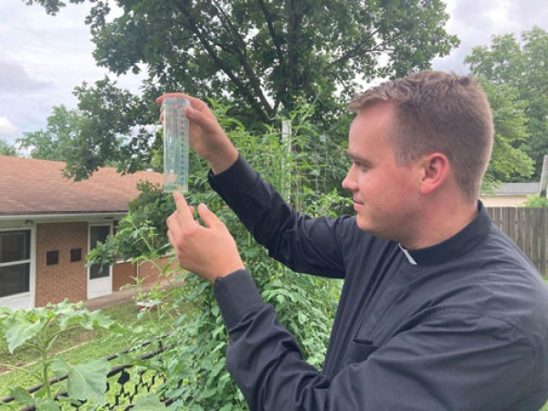 Priests, parishioners find fulfillment in planting, growing, harvesting