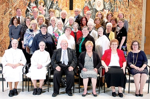 Twenty-eight Dominican associates make commitment Sixteen are residents of the diocese; long-time director honored