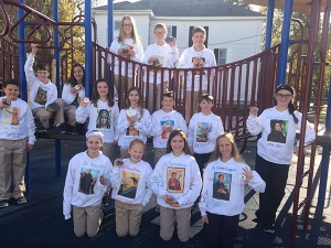 Taylorville sixth-graders spread the word about saints