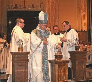 At chrism Mass, holy oils blessed, priests renew promises