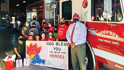 St. Ambrose Saints give thanks to heroes