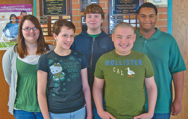 Holy Family students (left to right) Kim Galbraith, Emily Nelson, Thomas Hart, Josh Nelson and Ryan Glower won the highest ranking possible, an Outstanding ribbon, at the SIU-E IJAS Science Fair, March 13.